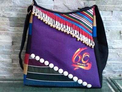 霓裳民族服饰用创意推动民族工艺饰品的发展